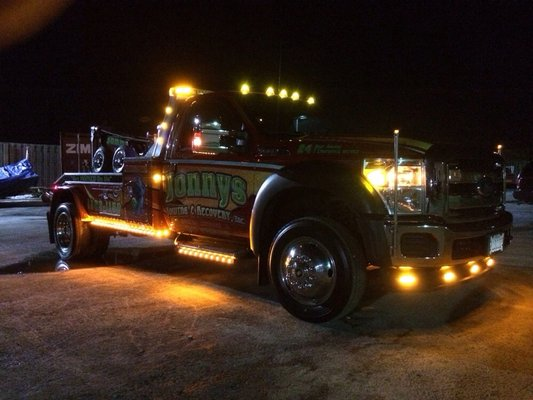 Jonny's Towing truck at night