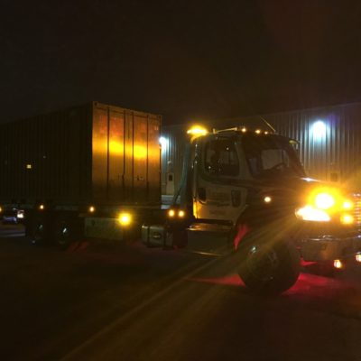 Jonny's Towing & Recovery Inc. flatbed towing, crate towing